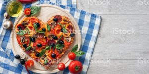 Delicious pizza served on white wooden table. High resolution product. Close up